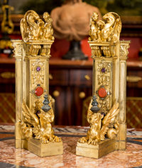 A Pair of French Renaissance Revival Gilt Bronze Chenets Mounted with Semi-Precious Stones, late 19th century One
