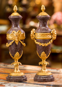 A Pair of Louis XVI-Style Gilt Bronze Mounted Rouge Marble Cassolettes 17 inches high (43.2 cm)