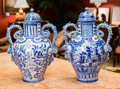 Ceramics & Porcelain, A Pair of Large Blue and White Majolica Lidded Urns, late 19th century. 20 h x 12 w x 10 d inches (50.8 x 30.5 x 25.4 cm). ... (Total: 2 Items)