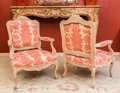 Furniture : French, Pair of Louis XVI-Style Upholstered Walnut Fauteuils, late 20thcentury. 41 h x 28 w x 23 d inches (104.1 x 71.1 x 58.4 cm)...(Total: 2 Items)