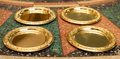 Decorative Arts, Continental, A Set of Four Esperanto Gilt Metal Bread and Butter Plates, late20th century. Marks: Esperanto. 6-1/4 inches diameter (...(Total: 4 Items)