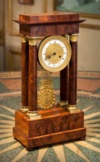 A Louis Philippe Mahogany and Gilt Bronze Portico Clock, mid-19th century 20 h x 10 w x 6 d inches (50.8 x 25.4 x
