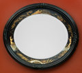 Decorative Arts, Continental, A Lacquered Japanesque Oval Mirror Frame, late 19th century. 24 h x27 w inches (61.0 x 68.6 cm). ...