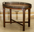 Furniture , A George III-Style Mahogany Tea Table with Fretwork Gallery, mid to late 19th century. 22-1/2 h x 28-1/2 w x 19-1/4 d inches...