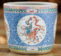 Asian, A Chinese Enameled Porcelain Jardinière. 12-1/4 inches high x13-3/4 inches diameter (31.1 x 34.9 cm). ...