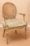 Furniture : French, A Louis XV-Style Painted Wood and Caned Fauteuil with UpholsteredCushion, 19th century. 37-1/4 h x 24 w x 20-1/2 d inches (...