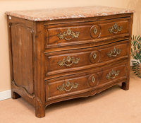 A Louis XV Carved Fruitwood Commode with Rouge Marble Top, late 18th century with later elements 37 h x 50-1/2 w x