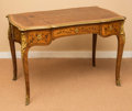 Furniture : French, A Louis XV-Style Marquetry Bureau Plat with Gilt Bronze Mounts andInset Leather Top, late 19th century. 30 h x 41-1/2 w x 2...