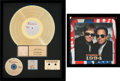 Music Memorabilia:Autographs and Signed Items, Elton John/Billy Joel Signed Program and For our ChildrenRIAA Gold Sales Award (Disney 60616-2, 1991).... (Total: 2 )