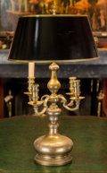 Decorative Arts, British, A George III-Style Brass Candelabrum Mounted as a Table Lamp. 25inches high (63.5 cm). ...