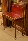 Furniture , A Queen Anne-Style Mahogany and Leather-Topped Folding Games Table, 19th century. 28-1/8 h x 33-5/8 w x 16-1/2 d inches (71....