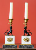 Decorative Arts, Continental:Lamps & Lighting, A Pair of Egyptian Revival-Style Marble, Gilt Bronze, and OnyxFigural Candlesticks, early 20th century. 8 inches high (20.3...(Total: 2 Items)