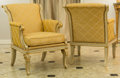 Furniture , A Pair of Empire-Style Partial Gilt Creme Peinte and Upholstered Bergères. 38 h x 26 w x 34 d inches (96.5 x 66.0 x 86.4 cm)... (Total: 2 Items)