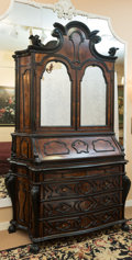 Furniture : Continental, A Dutch Rococo-Style Ebonized and Burl Walnut Secretary Bookcase. 101-1/2 h x 63 w x 25 d inches (257.8 x 160.0 x 63.5 cm)...