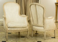 Furniture : French, A Pair of Louis XV-Style Upholstered and Painted Wood Bergères,20th century . 38-1/4 h x 27 w x 22-1/2 d inches (97.2 x 68....(Total: 2 Items)