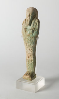 EGYPT. Late Dynastic Period, 30th Dynasty, reign of Nectanebo II (360-342 BCE). Green glazed faience ushabti for General...