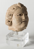 Judaica:History and Culture, NABATAEAN KINGDOM. Circa 50 BCE - 50 CE. Limestone bust of a young deity, perhaps Dionysus, Mithras or Yarhibol....