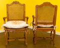 Furniture : French, A Pair of Louis XV-Style Carved Fruitwood and Caned Bergères withCushions, late 20th century. 43 h x 24 w x 21 d inches (10...(Total: 2 Items)