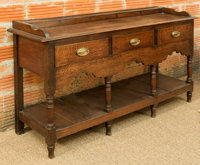 A George III Carved Oak Welsh Dresser, early 19th century 33 h x 58 w x 17 d inches (83.8 x 147.3 x 43.2 cm)