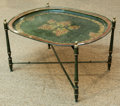 Furniture : Continental, An Italian Neoclassical-Style Painted Tole Tray Top Table , early20th century. 18 h x 29 w x 24 d inches (45.7 x 73.7 x 61....