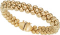 Jewelry, An Italian Gold Bracelet . DIMENSIONS: 6-3/4 inches x 3/8 inch. GROSS WEIGHT: 30.00 grams. The Italian Florentine-finished...