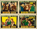 "Movie Posters:Western, Dodge City (Warner Brothers, 1939). Linen Finish Lobby Cards (4)(11"" X 14"").. ... (Total: 4 Items)"