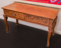 Furniture , An Anglo-Colonial Carved Teak Two-Drawer Library Table, early 20th century. 29-1/2 h x 51-1/2 w x 21 d inches (74.9 x 130.8 ...