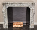 Furniture , A Striated Marble Fireplace Surround, 20th century. 43 inches high x 52 inches wide (109.2 x 132.1 cm). ...