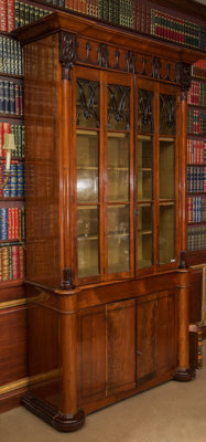 An English Gothic Revival Ebonized and Inlaid Mahogany and Rosewood Cabinet Bookcase, mid-19th century 104-1/2 h x