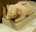 Asian, An Asian Carved Wood Elephant Stand on Plinth. 21-1/2 h x 41 w x 20d inches (54.6 x 104.1 x 50.8 cm) (overall). ...