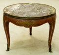 Furniture : Continental, A Polychrome and Gilt Side Table with Marble Top, 20th century.17-3/8 inches high x 21-1/4 inches diameter (44.1 x 54.0 cm)...