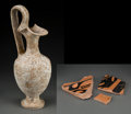 Judaica:Archaeology, SOUTHERN ITALY. Canosa. Circa 300-250 BCE. White glazed trefoilpitcher (oinochoe).... (Total: 2 Items)