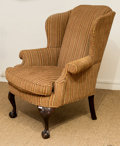 Furniture , A George III-Style Upholstered Mahogany Wingback Chair, early 20th century. 44 h x 36 w x 34 d inches (111.8 x 91.4 x 86.4 c...