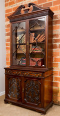 Furniture , A Chippendale-Style Glazed Carved Mahogany Cabinet, early 20th century. 100 h x 48 w x 20-1/2 d inches (254 x 121.9 x 52.1 c...