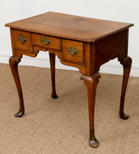 A George III Carved Oak Dressing Table, late 18th century with later elements 29 h x 31 w x 20 d inches (73.7 x 78