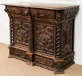 Furniture : Continental, A Continental Baroque-Style Carved Oak Cabinet, late 19th century.47 h x 59 w x 25 d inches (119.4 x 149.9 x 63.5 cm). ...