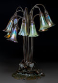 Art Glass:Tiffany , Tiffany Studios Bronze and Favrile Glass Twelve-Light Lily Lamp. 4Pastille shades and 7 Favrile shades.. Circa 1910. Stampe...