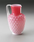 Art Glass:Other , A HOBNAIL GLASS PITCHER. Maker unknown. The footed hobnail glasspitcher with clear handle and bulbous body moving from pi...