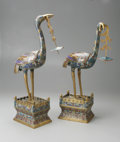 Decorative Arts, Continental:Other , A PAIR OF CLOISONNE CRANES. Makers unknown, c.1900. The hollowcranes, supported on a raised rectangular plinth, holds a c...