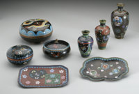 A GROUP OF CLOISONNE ITEMS Makers unknown, c.1900  Comprising a round covered box, black ground with an imperial yellow...