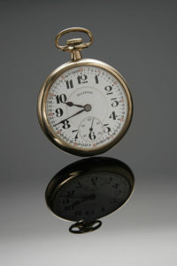 A GOLD POCKET WATCH Illinois Watch Co., Springfield, Illinois  The guaranteed gold-filled timepiece with white dial and...
