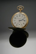 Clocks & Mechanical, A GOLD POCKETWATCH. Hampden Watch Co., Canton, Ohio. The 14k yellow gold-filled timepiece with white dial signed Hampden...