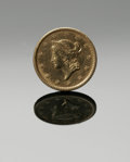 Jewelry, A ONE DOLLAR GOLD COIN. The United States one dollar yellow gold coin, dated 1851, formerly a piece of jewelry. .55in. dia... (Total: 1 Item Item)