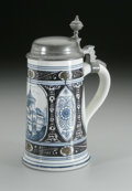 Ceramics & Porcelain, A GERMAN EARTHENWARE STEIN. Villeroy & Boch, c.1890. The ivory ground cylindrical half-litre stein decorated with a blue a... (Total: 1 Item Item)