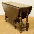 Furniture : American, A Diminutive Early American-Style Oak Gate-Leg Table, late 20thcentury. 20 inches high x 36 inches diameter (50.8 x 91.4 cm...