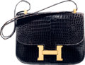 Luxury Accessories:Bags, Hermes 23cm Shiny Blue Marine Crocodile Single Gusset Constance Bag with Gold Hardware. B Circle, 1972. Good Condition...
