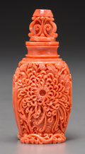 Asian:Chinese, A Chinese Carved Coral Snuff Bottle. 3-3/8 inches high (8.6 cm).124 grams. The well-carved bottle with chrysanthemum to o...