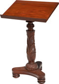 Furniture : American, An American Classical Carved Mahogany Book Stand, 19th century.34-3/4 h x 22 w x 17 d inches (88.3 x 55.9 x 43.2 cm). ...