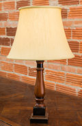 Decorative Arts, Continental, A Turned Partial Ebonized Wood Table Lamp. 31-1/2 inches high (80.0cm). ...