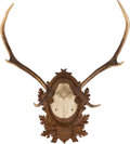 Decorative Arts, Continental, A Continental Deer Antler Trophy Mount. 25 inches high x 22 incheswide (63.5 x 55.9 cm). ...